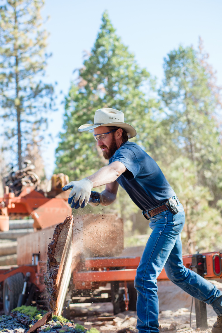 Lumberjack working at a lumber mill