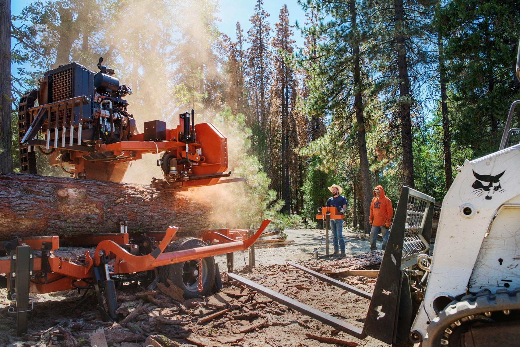 Woodmizer sawing through fresh cut logs